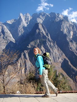 Photo of Allison Thompson in front of a tall mountain range