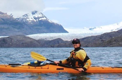 Photo of Dan Pond kayaking near a glacier