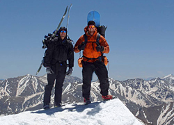 Photo of students on top of a snowy mountain