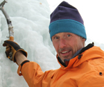 Portrait of Don Mellor climbing on ice.