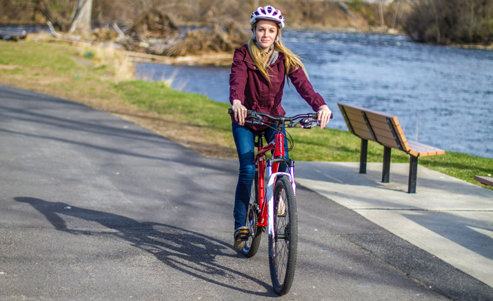 Photo of SUNY Plattsburgh student riding a rental bike