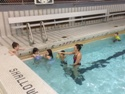 Photo of kids receiving instructions during Saturday Morning Learn to Swim Class
