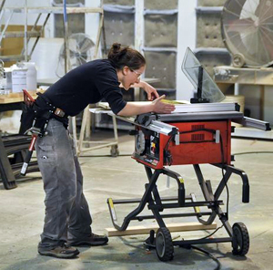 Photo of Allison Oropallo using saw table