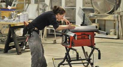 Photo of Allison Oropallo working at a table saw