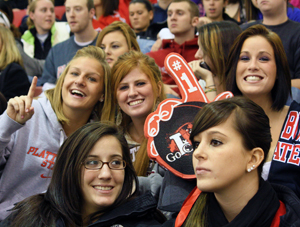 Photo of students watching SUNY Plattsburgh men's hockey team play Oswego at Homecoming