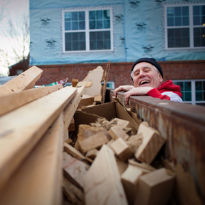 Photo of Dr. Richard Semmler working on Habitat for Humanity project.