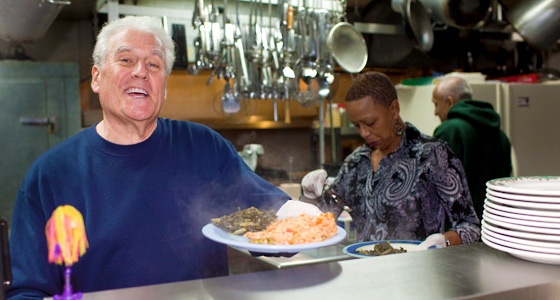 Photo of Richard Semmler volunteering in a soup kitchen