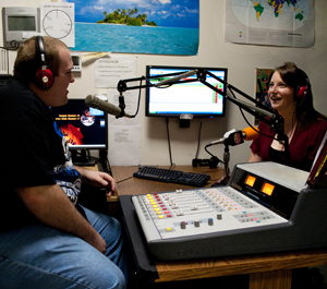 Photo of Brian Smith and Abigail Curran on air at WARP radio station