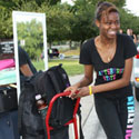 Photo of students carrying belongings to their dorms on Move-In Day
