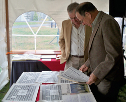 Delta Kappa Delta brothers look over memorabilia at a recent ceremony honoring members who have died and recognizing members' gifts to the college.
