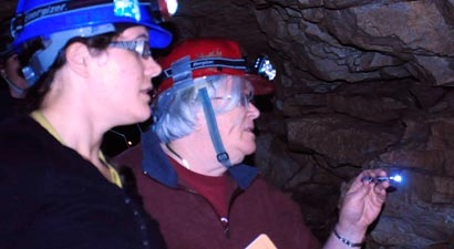 Photo of Kathy Lavoie and a student working in a cave