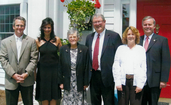 Photo of Todd Moravec, Lisa Lewis, Phyllis Wells, Dr. John Ettling, Debra Kimok and Bill Laundry in front of the Olive Mason Flynt House