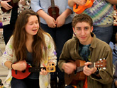 Photo of the Uke-a-Dooks playing their ukuleles