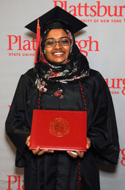 Photo of SUNY Plattsburgh student holding her diploma