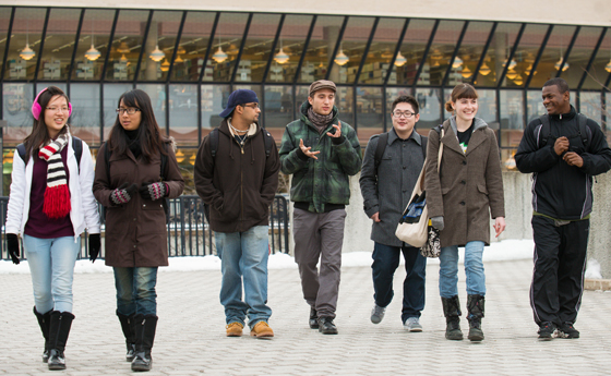 Photo of SUNY Plattsburgh students walking in front of Feinberg Library