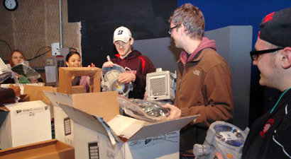 Photo of students unpacking the new lights for the TV studio.