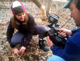 Photo of Rachel Schultz being filmed for a video about skunk cabbages.