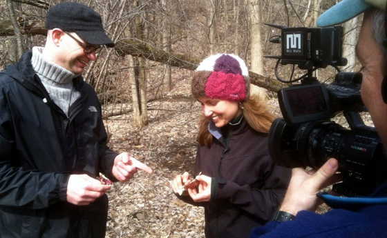 Photo of Drs. Rachel Schultz and Chris Martine discuss skunk cabbage in front of the video camera.