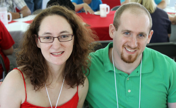 Photo of Kristy '07 and Harry '08 Silman at clambake during the college's Reunion