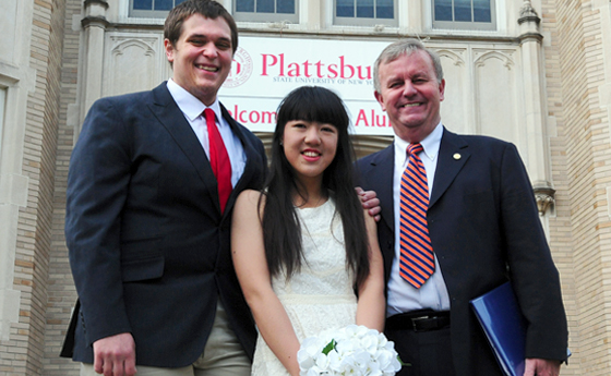 Tim Maggio '13, Zi Wang  and Bill Laundry standing in front of Hawklins Hall