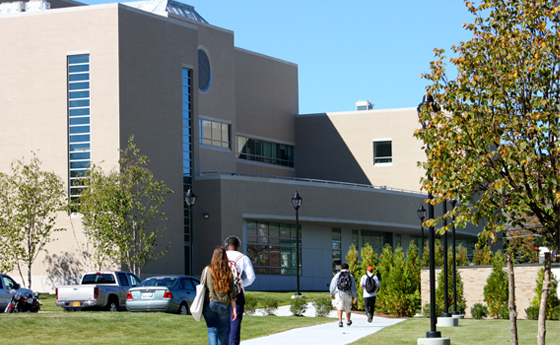 Photo of students in front of the newly constructed Au Sable building