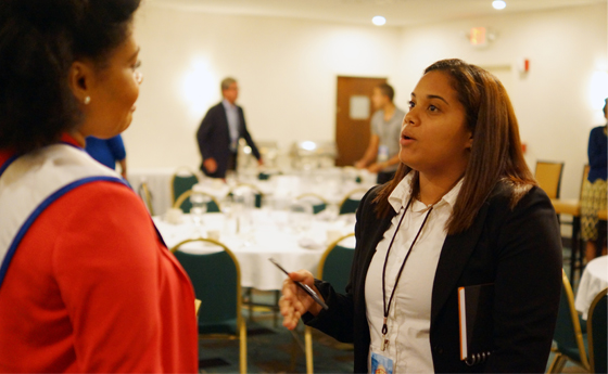 Photo of student in conversation with SUNY Plattsburgh alumna