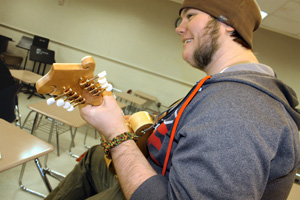 Photo of a student playing bluegrass