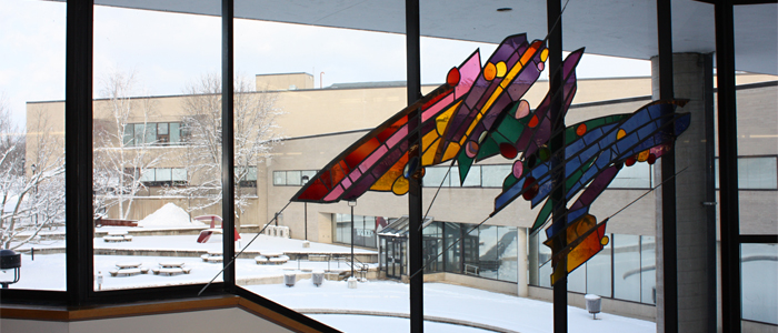 Photo of a stained glass installation in Angell College Center