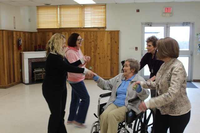 memory cafe dancing with wheelchair woman