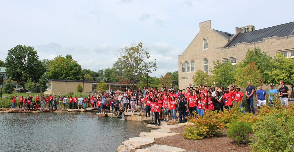 international students at pond