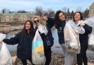 Fraternity, Sorority Members Lead Day of Caring Effort to Clean Up Community